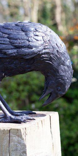 bronze crow head bent